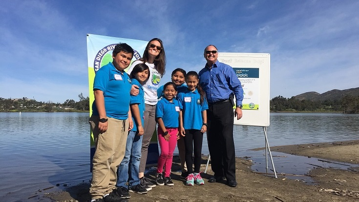 This morning, students from King-Chavez Academy were joined by Mike Schneider, SDG&E's chief environmental officer and vice president of operations support, at Lake Murray to give something special back to our local watershed—trout!